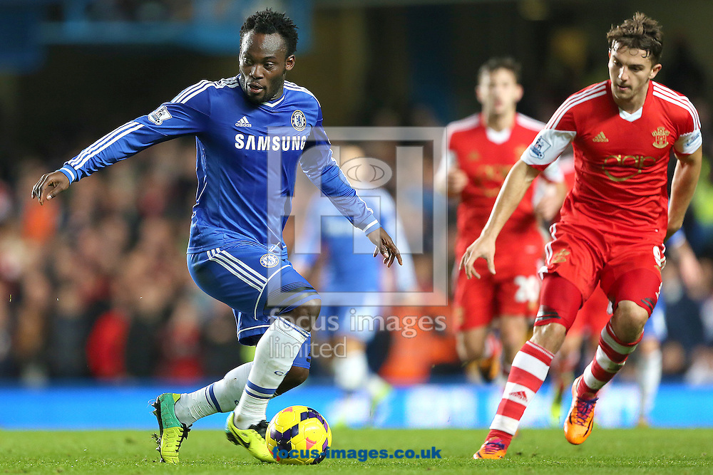 Picture by Richard Calver/Focus Images Ltd +447792 981244<br /> 01/12/2013<br /> Michael Essien of Chelsea and Jay Rodriguez of Southampton during the Barclays Premier League match at Stamford Bridge, London.