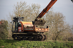 ©  London News Pictures. 31/03/2014. Burrowbridge, UK. Dredging starts on a stretch of the River Parrett between Burrowbridge and Moorland in Somerset. Dredging on the Somerset Levels has started as part of a package of measures aimed at preventing a repeat of the winter floods. Work is beginning on five miles (8km) of the rivers Parrett and Tone. Other measures recommended in a £100m, 20-year Flood Action Plan include a tidal barrage and extra pumping sites. Photo credit: Ed Stone/LNP