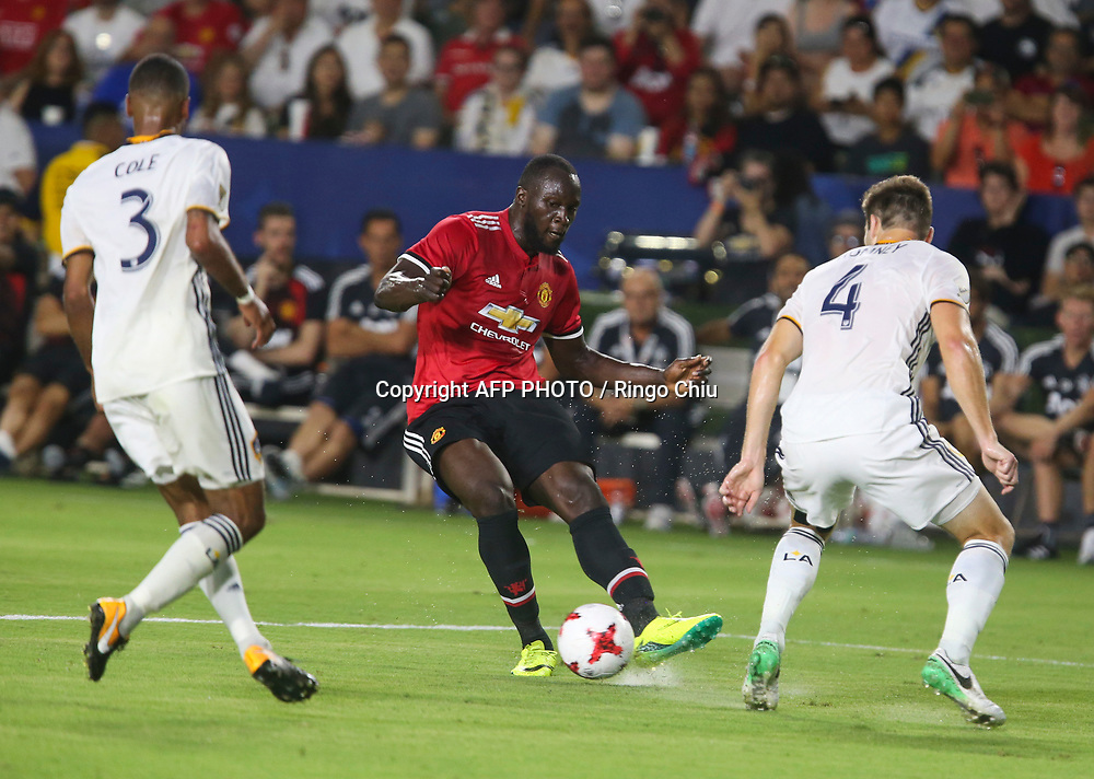 Manchester United Romelu Lukaku, center, kicks the ball against Los Angeles Galaxy during the second half of a national friendly soccer game at StubHub Center on July 15, 2017 in Carson, California. The Manchester United won 5-2. AFP PHOTO / Ringo Chiu