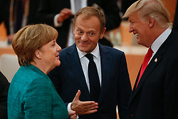 July 8, 2017 - Hamburg, Germany - U.S. President DONALD TRUMP, right, shares a laugh with European Council president DONALD TUSK, center, and German chancellor ANGELA MERKEL ahead of the third plenary session of the G20 summit. (Credit Image: © Jaap Arriens/NurPhoto via ZUMA Press)
