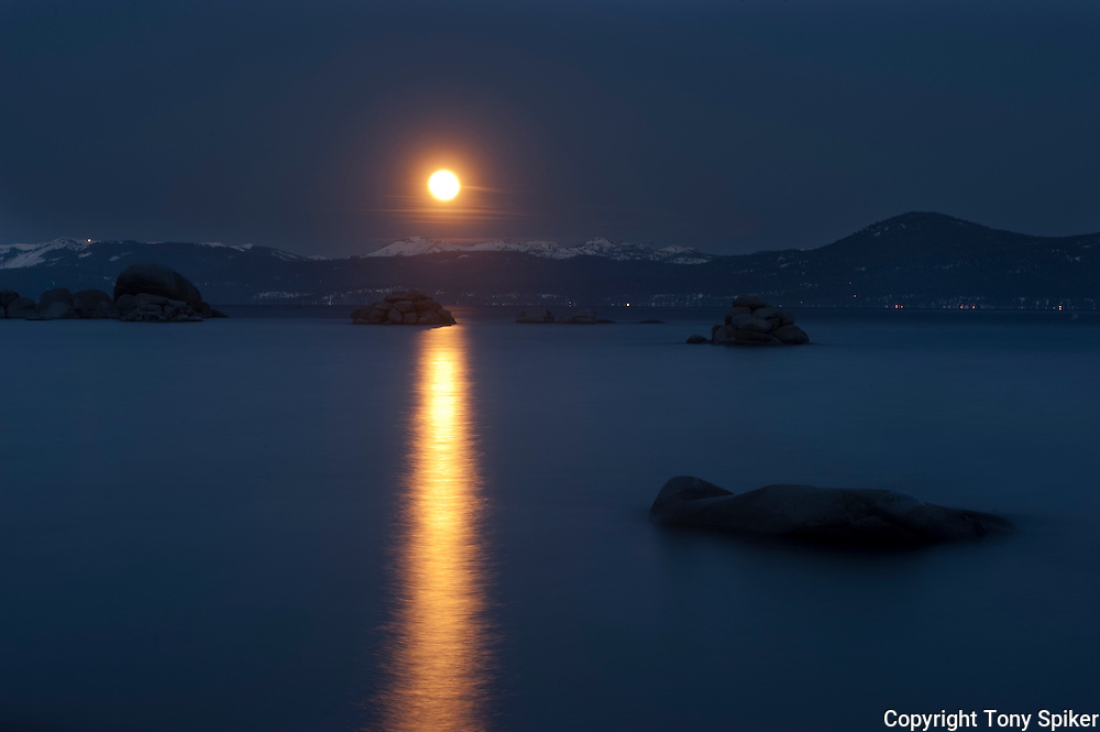 """Moonset at Sand Harbor 1"" - The moon sets as the sun rises at Sand Harbor on the Eastern shore of Lake Tahoe"
