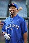 ANAHEIM, CA - AUGUST 2:  Emilio Bonifacio #1 of the Toronto Blue Jays has a laugh during batting practice before the game against the Los Angeles Angels of Anaheim on Friday, August 2, 2013 at Angel Stadium in Anaheim, California. The Angels won the game 7-5. (Photo by Paul Spinelli/MLB Photos via Getty Images) *** Local Caption *** Emilio Bonifacio