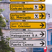 Signs guiding tourists in La Habana Vieja. Photography by Jose More