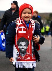 A young Liverpool fan wearing a scarf featuring Liverpool's Mohamed Salah
