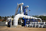 Desalination plant. The main pipe connect this facility to the Israeli water supply. This facility turns salt water into drinking water using the Reverse Osmosis Process and will produce 127 million cubic metres of fresh water each year. Photographed in Hadera, Israel.