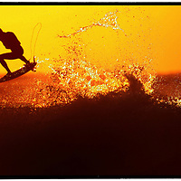 April 6, 2007. The Rip Curl Pro Surfing Championships at Bells Beach, Victoria. Kelly Slater warms up at dawn with an aerial before competition started today. <br /> Photographer<br /> Shannon Morris