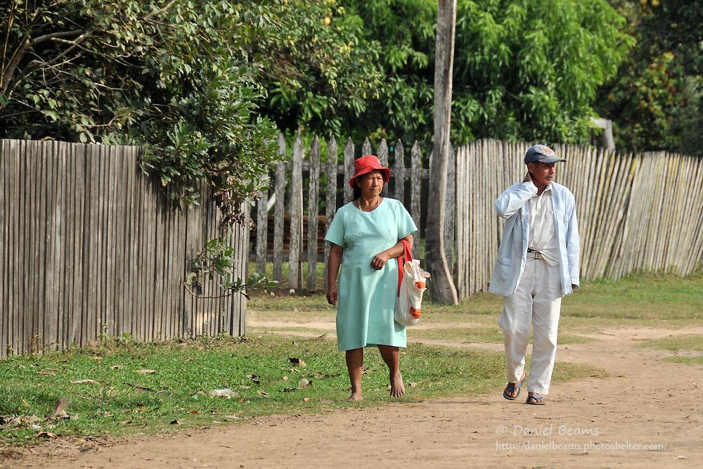 Older couple walking on the streets of San Lorenzo de Moxos, Beni, Bolivia