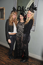 Left to right, CARA DELEVINGNE, STACEY BENDET and POPPY DELEVINGNE at a carnival themed party hosted by Stacey Bendet for the Alice & Olivia fashion label at Paradise, Kensal Green, London on 9th November 2011