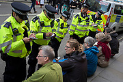 Environmental activists are arrested while protesting about Climate Change during the blockade of Whitehall in central London, part of a two-week prolonged worldwide protest by members of Extinction Rebellion, on 16th October 2019, in Westminster, London, England.