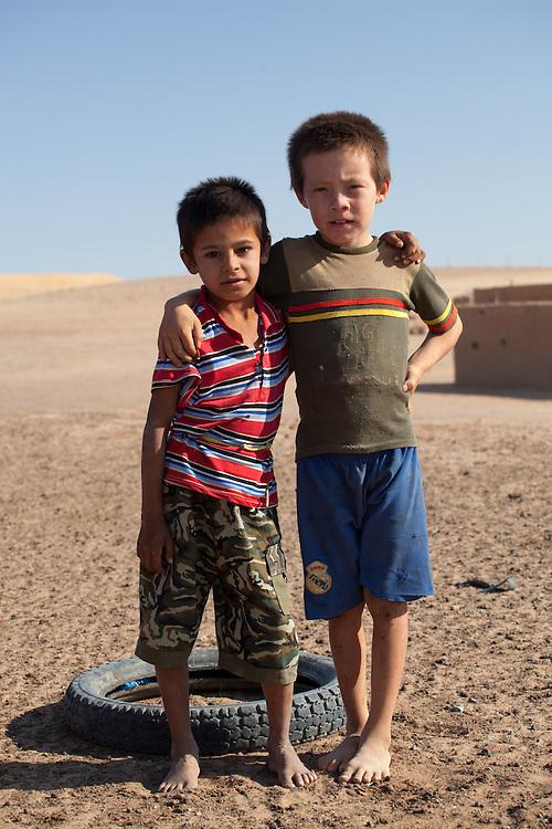 Two young boys in a remote village, Karakum Desert, Turkmenistan