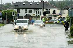 Torrential rain causes flooding and traffic chaos as vehicles try to make their way through floodwater on The Common Ecclesfield Sheffield South Yorkshire.25 June 2007.Image COPYRIGHT Paul David Drabble.