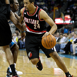 March 30, 2011; New Orleans, LA, USA; Portland Trail Blazers point guard Andre Miller (24) drives past New Orleans Hornets point guard Chris Paul (3) during the third quarter at the New Orleans Arena. The Hornets defeated the Trail Blazers 95-91.   Mandatory Credit: Derick E. Hingle