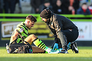 Forest Green Rovers physio Joe Baker treats Forest Green Rovers Josh March(28) during the EFL Sky Bet League 2 match between Forest Green Rovers and Salford City at the New Lawn, Forest Green, United Kingdom on 18 January 2020.