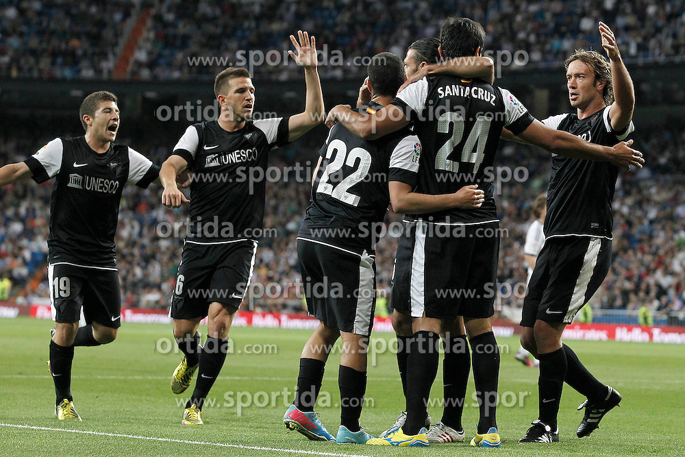 08.05.2013, Estadio Santiago Bernabeu, Madrid, ESP, Primera Division, Real Madrid vs FC Malaga, 36. Runde, im Bild Malaga's Francisco Portillo, Ignacio Camacho, Isco, Martin Gaston Demichelis, Roque Santa Cruz and Diego Alfredo Lugano celebrate goal // during the Spanish Primera Division 36th round match between Real Madrid CF and Malaga FC at the Estadio Santiago Bernabeu, Madrid, Spain on 2013/05/08. EXPA Pictures © 2013, PhotoCredit: EXPA/ Alterphotos/ Acero..***** ATTENTION - OUT OF ESP and SUI *****
