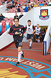 LONDON, ENGLAND - Saturday, September 19, 2009: Liverpool's Yossi Benayoun runs out to warm-up before the Premiership match against West Ham United at Upton Park. (Pic by David Rawcliffe/Propaganda)
