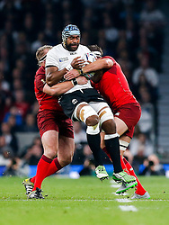Fiji replacement Tevita Cavubati is tackled by England Prop Joe Marler and Flanker Tom Wood - Mandatory byline: Rogan Thomson/JMP - 07966 386802 - 18/09/2015 - RUGBY UNION - Twickenham Stadium - London, England - England v Fiji - Rugby World Cup 2015 Pool A.