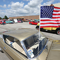 Cars and spectators begin to fill up the parking lot at the BancorpSouth Arena on Friday to kick off this year's Blue Suede Cruise event.