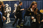 Rick Santorum walks back up to the table for his book signing as he is passed by Storm Troopers in the HUB during day two of the Conservative Political Action Conference (CPAC) at the Gaylord National Resort & Convention Center in National Harbor, Md.