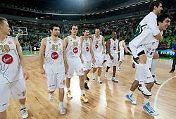 Sasu Salin (10) of Olimpija, Saso Ozbolt (31) of Olimpija, Klemen Lorbek (25) of Olimpija, Goran Jagodnik (12) of Olimpija, Damir Markota (22) of Olimpija, Kenny Gregory (9) of Olimpija, Zoran Vrkic of Olimpija and Giorgi Shermadini (16) of Olimpija celebrate after winning the basketball match between KK Union Olimpija (SLO) and Armani Jeans Milano (ITA) in Group D of Turkish Airlines Euroleague, on December 2, 2010 in SRC Stozice, Ljubljana, Slovenia. Union Olimpija defeated AJ Milano 82-75 and qualified to 16 best teams of Euroleague.  (Photo By Vid Ponikvar / Sportida.com)