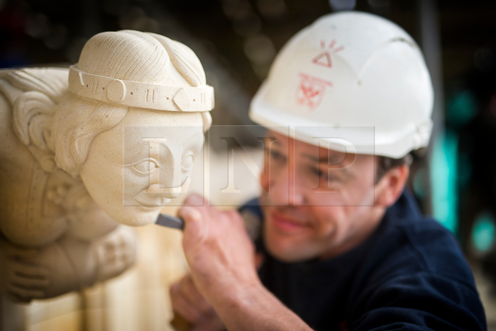 © Licensed to London News Pictures. 27/09/2017. York UK. Stone Mason Richard Bossons puts the finishing touches to the first collection of new grotesques to be carved for York Minster's 11 year project to conserve its South Quire Aisle have been installed today. The four carvings have been based on the Judgement of Solomon & include King Solomon, two women- one carrying a baby & a dragon holding a goose between it's teeth. The grotesques are being returned to a newly restored pinnacle, to replace four weathered carvings which are believed to date from the 1700s. Although badly eroded, the cathedral's stonemasons could make out two women - one holding a bundle – a male figure and evidence of a winged beast with a bird between its teeth. Work on the South Quire Aisle, which dates from the 14th century, began at the start of 2016 and will involve an £11m investment over the next decade to repair and replace stone and glass in 15 window bays.Photo credit: Andrew McCaren/LNP