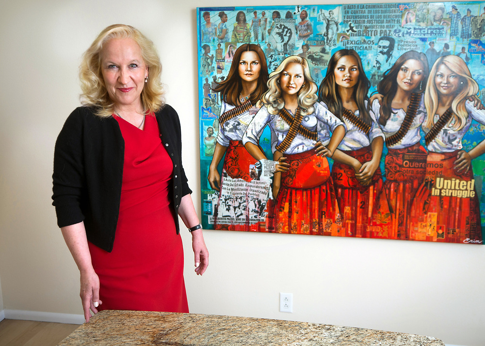 mkb041217b/metro/Marla Brose --  Albuquerque lawyer Randi McGinn works in her office at McGinn Carpenter Montoya & Love, a law firm that McGinn, who has been practicing law since 1980, founded. The conference room in the firm has a painting by Erin Currier of McGinn and the other lawyers that she has worked with in the firm. McGinn was the special prosecutor in the State of N.M. vs. Keith Sandy and Dominique Perez. (Marla Brose/Albuquerque Journal)