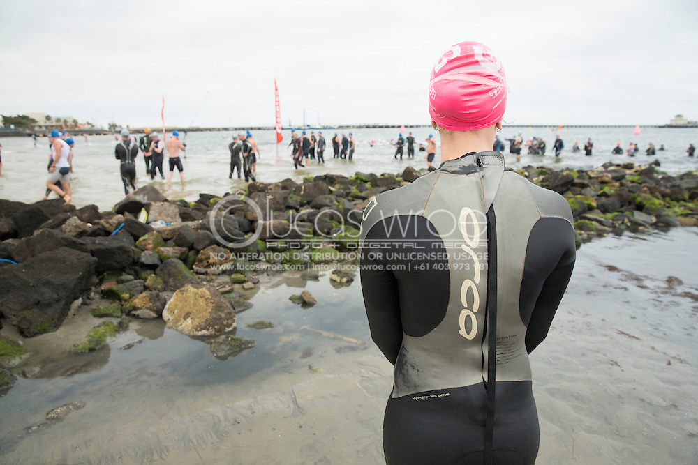 Contemplating the swim start. 2012 Gatorade Triathlon Series Race 1. St Kilda, Victoria, Australia. 25/11/2012. Photo By Lucas Wroe