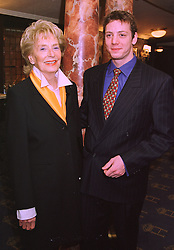 MRS ENID CHANELLE president of the Theatre Royal and her grandson MR DAMIAN CROOK, at a reception in London on 3rd February 1998.MFB 1
