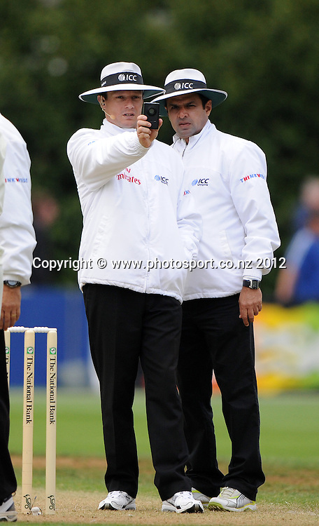 ICC umpires Richard Kettlebrough and Aleem Dar check the light. Test match cricket. Third Test, Day 1. New Zealand Black Caps versus South Africa Proteas, Basin Reserve, Wellington, New Zealand. Friday 23 March 2012. Photo: Andrew Cornaga/Photosport.co.nz