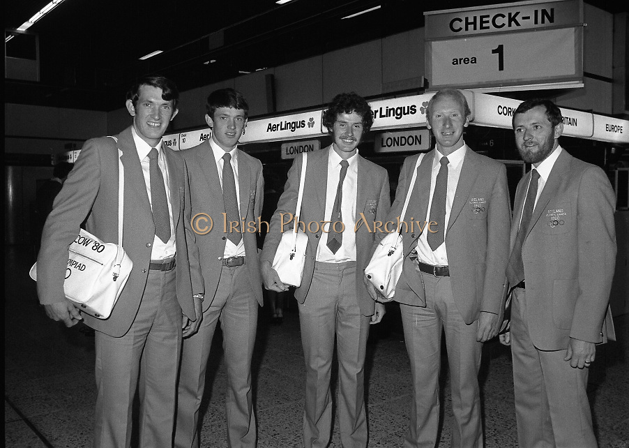Olympic Competitors Depart for Moscow..1980-07-14.14th July 1980.14/07/1980.07-14-80..Photographed at Dublin Airport...Olympic Competitors Depart for Moscow..1980-07-14.14th July 1980.14/07/1980.07-14-80..Photographed at Dublin Airport...Oarsmen prepare to fly out to Moscow for the Olympic Games...From Left:..Brothers, Willie and .Ted Ryan (Clonakilty)..Denis Rice (Fermoy)..Christy O'Brien (Fermoy)..Coach John Holland (Cork).