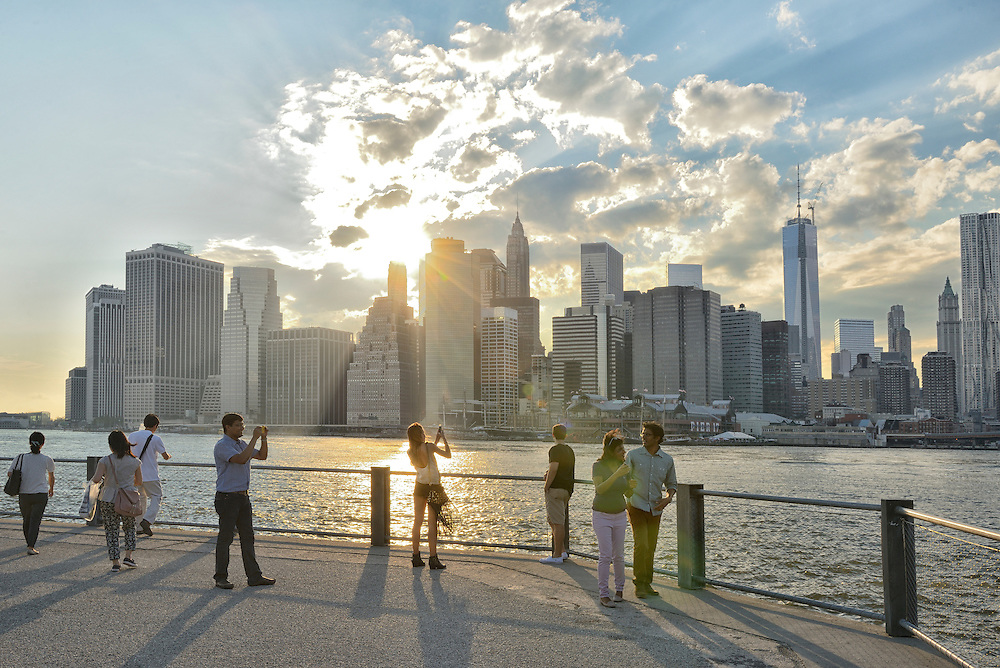 People at Brooklyn Bridge Park with Sklyline of Lower Manhattan at sunset,New York, USA