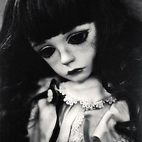 portrait of a sad colette the doll
