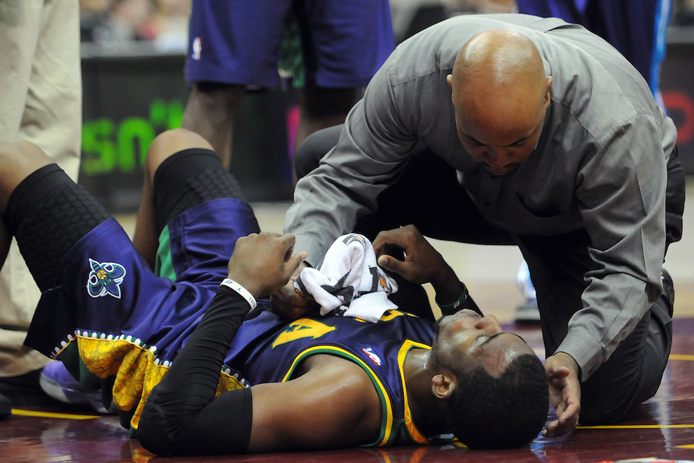 March 6, 2011; Cleveland, OH, USA; New Orleans Hornets point guard Chris Paul (3) is tended to by a trainer after taking a hard fall during the third quarter against the Cleveland Cavaliers at Quicken Loans Arena. Mandatory Credit: Jason Miller-US PRESSWIRE