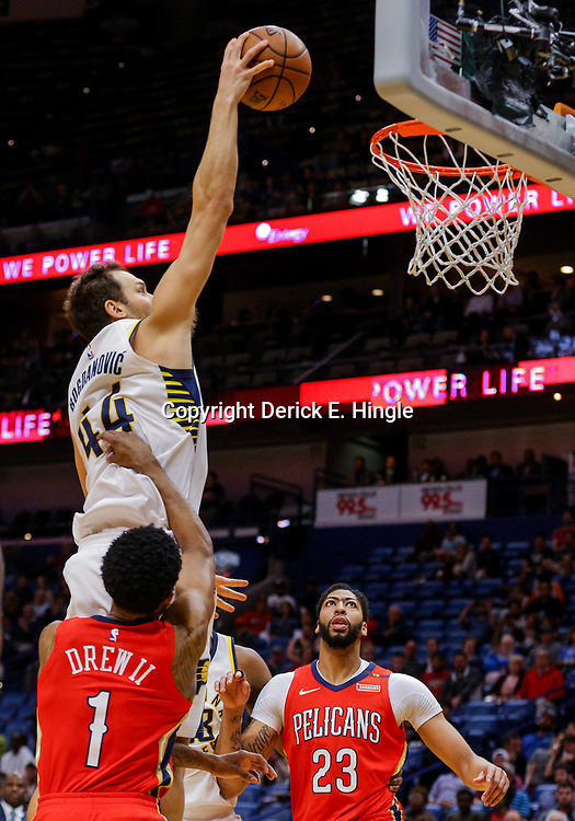 Mar 21, 2018; New Orleans, LA, USA; Indiana Pacers forward Bojan Bogdanovic (44) dunks over New Orleans Pelicans guard Larry Drew II (1) and forward Anthony Davis (23) during the first quarter at the Smoothie King Center. Mandatory Credit: Derick E. Hingle-USA TODAY Sports