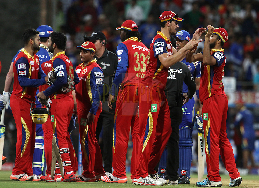 Royal Challengers Bangalore and Mumbai Indians players shake hands after the match 46 of the Pepsi IPL 2015 (Indian Premier League) between The Mumbai Indians and The Royal Challengers Bangalore held at the Wankhede Stadium in Mumbai, India on the 10th May 2015.<br /> <br /> Photo by:  Vipin Pawar / SPORTZPICS / IPL