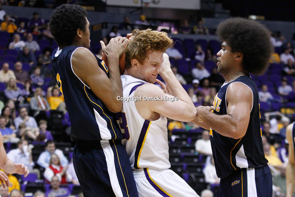 December 15, 2011; Baton Rouge, LA; UC Irvine Anteaters forward Will Davis II (3) rips the ball away from LSU Tigers forward Eddie Ludwig (13) during the second half of a game at the Pete Maravich Assembly Center. LSU defeated UC Irvine 66-59.  Mandatory Credit: Derick E. Hingle-US PRESSWIRE