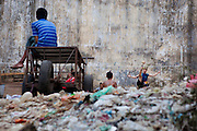 Playing chinlone surrounded by rubbish. Yangon, Myanmar