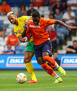 Pelly Ruddock Mpanzu of Luton Town (right) holds off John Bostock of Royal Antwerp during the Pre Season Friendly match at Kenilworth Road, Luton<br /> Picture by David Horn/Focus Images Ltd +44 7545 970036<br /> 26/07/2014