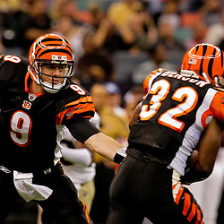 2009 August 14: Cincinnati Bengals quarterback Carson Palmer (9) handsoff to running back Cedric Benson (32) during a preseason opener between the Cincinnati Bengals and the New Orleans Saints at the Louisiana Superdome in New Orleans, Louisiana.