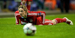 LIVERPOOL, ENGLAND - Wednesday, December 9, 2009: Liverpool's Fernando Torres is fouled by AFC Fiorentina's captain Per Kroldrup during the UEFA Champions League Group E match at Anfield. (Photo by David Rawcliffe/Propaganda)