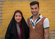 Iran, Tehran province, Tehran, smiling Iranian couple. Young Iranian men, like this man in Esfahan, have begun to pluck their eyebrows to the chagrin  of the Islamic authorities.