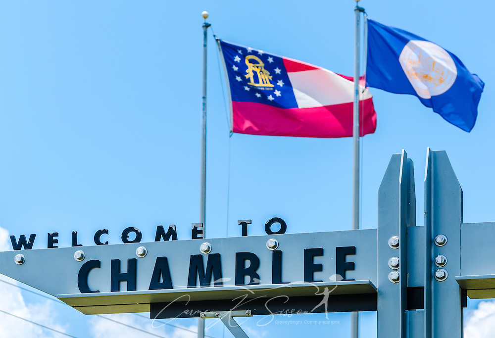 "A welcome sign hangs outside Chamblee City Hall in Chamblee, Georgia, June 10, 2014. Chamblee was incorporated in 1907 and had a population of 9,892 people according to the 2010 U.S. Census. The city's motto is, ""A City on the Right Track."" (Photo by Carmen K. Sisson/Cloudybright)"