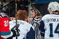 KELOWNA, CANADA - OCTOBER 14: Referee Kevin Bennett calls players to the penalty box on October 14, 2016 at Prospera Place in Kelowna, British Columbia, Canada.  (Photo by Marissa Baecker/Shoot the Breeze)  *** Local Caption *** Kevin Bennett;