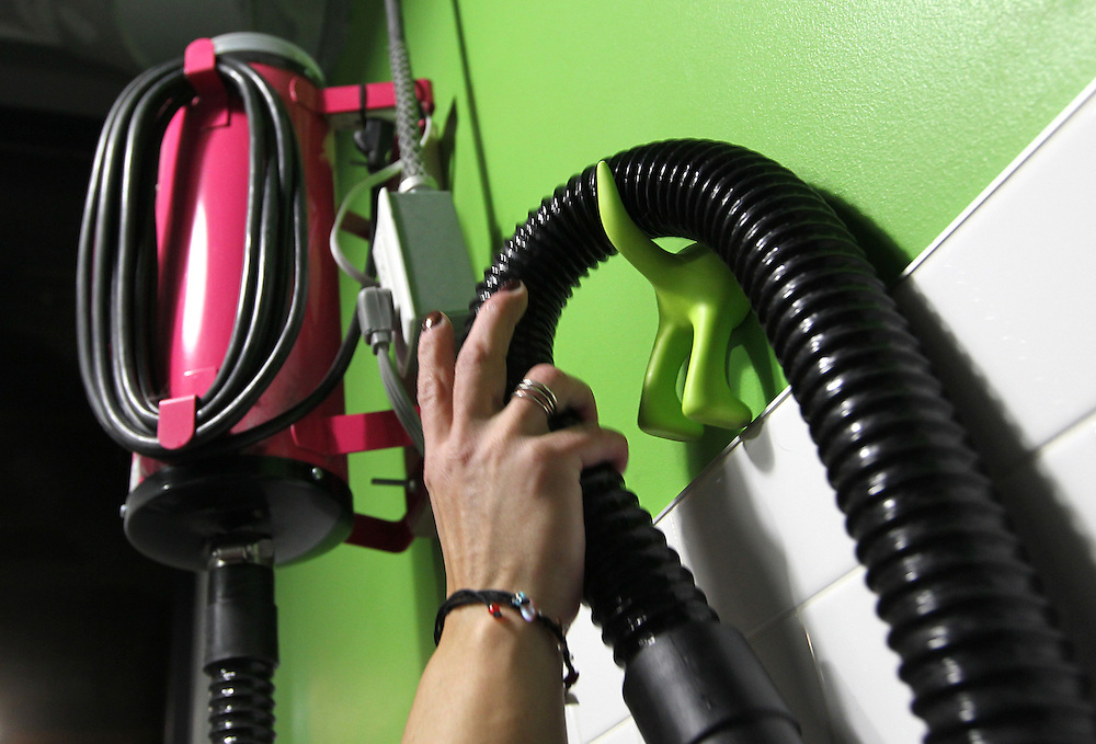 A customer takes the dog hair dryer from its perch on a dog-themed hook in the self-serve dog wash area at Ollu Dog Salon in Minneapolis November 14, 2012.