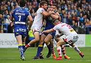 Toby King (C) of Warrington Wolves tackled by Ryan Morgan and Jon Wilkin of St Helens during the Betfred Super League Super 8s match at the Halliwell Jones Stadium, Warrington<br /> Picture by Stephen Gaunt/Focus Images Ltd +447904 833202<br /> 22/09/2018
