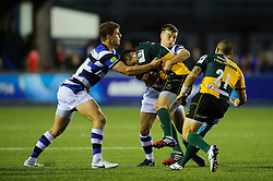 Bath Inside Centre Ollie Devoto and Fly-Half George Ford tackle Northampton Fly-Half Stephen Myler - mandatory by-line: Rogan Thomson/JMP - Tel: 07966 386802 - 23/05/2014 - SPORT - RUGBY UNION - Cardiff Arms Park, Wales - Bath Rugby v Northampton Saints - Amlin Challenge Cup Final.
