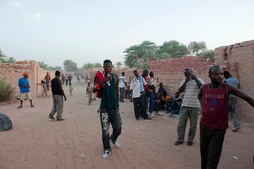 African migrants in a street of Dikou. There are all waiting to go to libya.