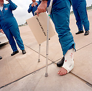 Engineering ground staff of the Red Arrows, Britain's RAF aerobatic team, one with a recently broken ankle.