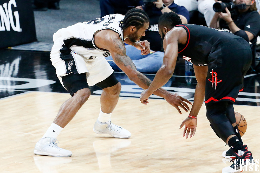 03 May 2017: San Antonio Spurs forward Kawhi Leonard (2) steals the ball from Houston Rockets guard James Harden (13) during the San Antonio Spurs 121-96 victory over the Houston Rockets, in game 2 of the Western Conference Semi Finals, at the AT&T Center, San Antonio, Texas, USA.