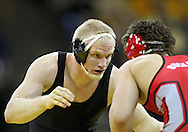 January 22 2010: Iowa's Luke Lofthouse eyes Ohio State's Peter Capone during the 197-pound bout an NCAA wrestling dual at Carver-Hawkeye Arena in Iowa City, Iowa on January 22, 2010. Lofthouse defeated Capone 6-4 and Iowa defeated Ohio State 33-3..