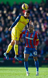 LONDON, ENGLAND - Saturday, February 21, 2015: Arsenal's Francis Coquelin in action against Crystal Palace's Jason Puncheon during the Premier League match at Selhurst Park. (Pic by David Rawcliffe/Propaganda)